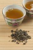 Cups with green gunpowder tea Stock Photography