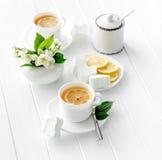 Cups of green herbal tea, jasmine flowers royalty free stock photo