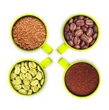 Cups with green, roasted coffee beans, ground and Royalty Free Stock Image