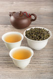 Cups of green tea and leaves Stock Image