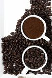 Cups with ground coffee and coffee beans, vertical, top view Royalty Free Stock Photography