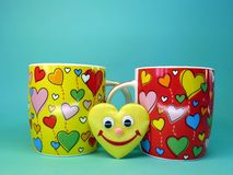 Cups and heart Stock Photography