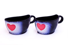 Cups with hearts Royalty Free Stock Image