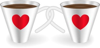 Cups with hearts. Two cups with intertwined handles decorated with  hearts Stock Photo