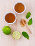 Cups of herbal  tea with aromatic herbal with lemon , lime Royalty Free Stock Photo