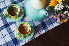 Cups of herbal tea with chamomile and mint leaves on the wooden background Stock Image