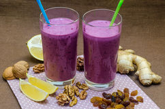 Cups homemade smoothies with straws. Useful food fresh raw foods. Royalty Free Stock Photos