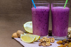 Cups homemade smoothies with straws. Useful food fresh raw foods. Stock Photos