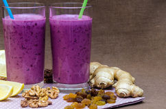 Cups homemade smoothies with straws. Useful food fresh raw foods. Stock Images
