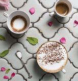 Cups of hot aromatic coffee and chocolate. stock photography