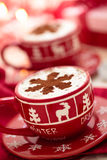 Cups with hot chocolate for Christmas day. Stock Photos