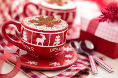 Cups with hot chocolate for Christmas day. Royalty Free Stock Photo