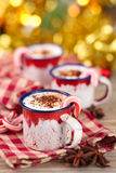 Cups with hot chocolate for Christmas day. Stock Images