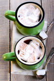 Cups of hot chocolate and marshmallows Stock Image