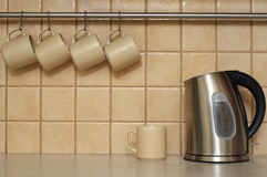 Cups and kettle Stock Images