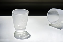 Cups of liquor. Delicate cups of liquor sandblasted with drawings of animals Royalty Free Stock Photo