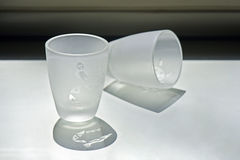 Cups of liquor. Delicate cups of liquor sandblasted with drawings of animals Stock Photo