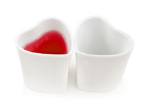 2 Cups of love. 2 Cups of red and blank Royalty Free Stock Photography