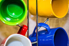 Cups and mugs hanging on a holde Royalty Free Stock Image