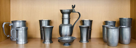 Cups and mugs made from tin Stock Images