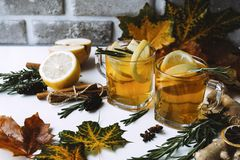 Free Cups Of Fruit Tea With Lemon And Orange, Rosemary, Cinnamon Stick, Ginger, Star Anise On A Background Of Maple Leaves Royalty Free Stock Photo - 160353685