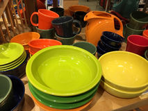 Cups and plates line up Stock Images