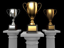 Cups on podium on black background. Royalty Free Stock Image