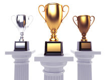 Cups on podium on white background. Royalty Free Stock Photos