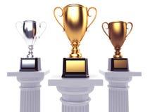 Cups on podium on white background. Royalty Free Stock Photos