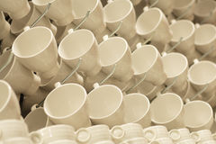 Cups on rack Stock Images