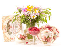 Cups, raspberry and flowers Stock Images