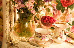 Cups, raspberry and flowers Royalty Free Stock Image