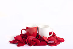 Cups on red rose petals Royalty Free Stock Images