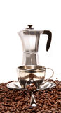Cups resting on coffee beans with percolator Stock Photography