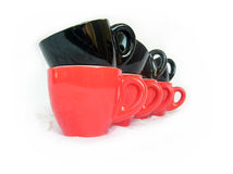 Cups row over white. Row of black and red small coffee cups over white Stock Photography