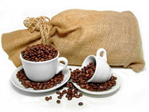 Cups and sack. Sack and two cups with fresh coffee Royalty Free Stock Images