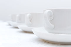 Cups on saucers Stock Photos