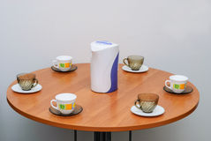 Cups and saucers. On the edge of a round table royalty free stock images