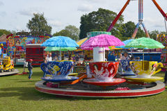 Cups and saucers fairground ride. A colouful cups and saucers revolving fairground ride at Rotherham show 2015 Stock Images