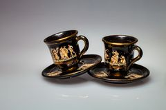 Cups and saucers with Greek motifs Stock Photos