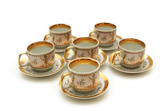 Cups and saucers isolated Stock Photography