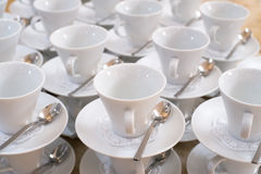 Cups on saucers with teaspoons Royalty Free Stock Image