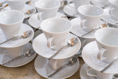 Cups on saucers with teaspoons Stock Photos