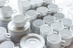Cups set on saucers in stacks. Royalty Free Stock Images