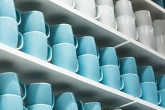 Cups on the shelves Royalty Free Stock Photos