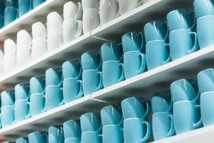 Cups on the shelves Stock Photo
