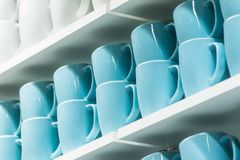 Cups on the shelves Royalty Free Stock Photo