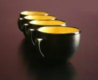 cups skrivbord fyra Arkivfoton