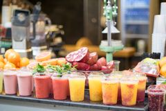 Smoothie fruit juice smoothies drinks with fruits in street market Jerusalem. Cups with smoothies and fruits on a black wooden table stock photos