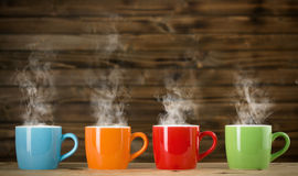 Cups with steaming drink Stock Photography